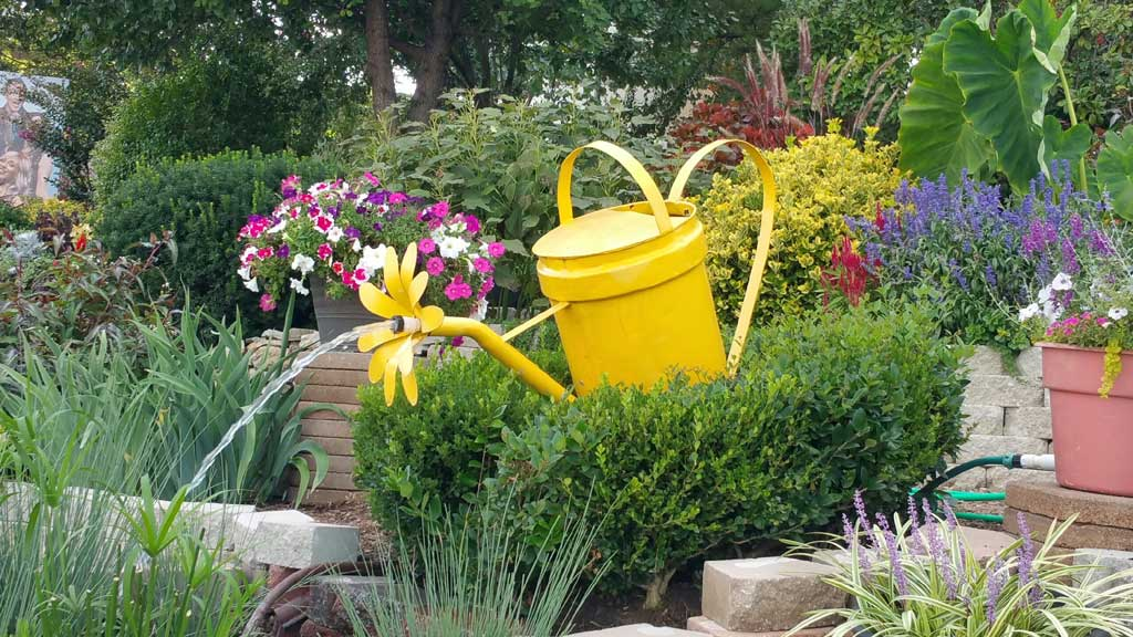 Watering can fountain at Veterans Memorial Garden in Branson, MO.