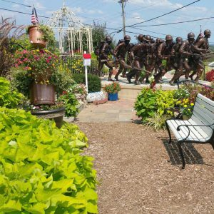 View of planter, statue, bench and more at Veterans Memorial Garden in Branson, MO.
